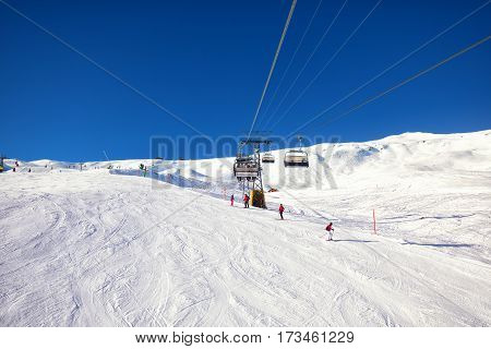Chairlift in Jungfrau ski resort in Swiss Alps with famous Eiger Monch and Jungfrau mountain Grindelwald Berner Oberland Grindelwald Switzerland.