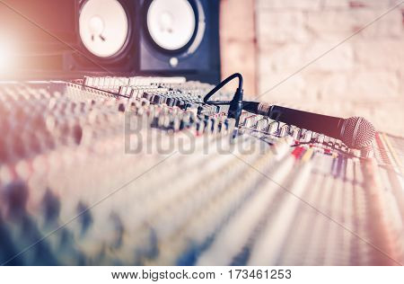 Studio Mixer and the Microphone. Audio Recording Concept Photo. Sound Systems.