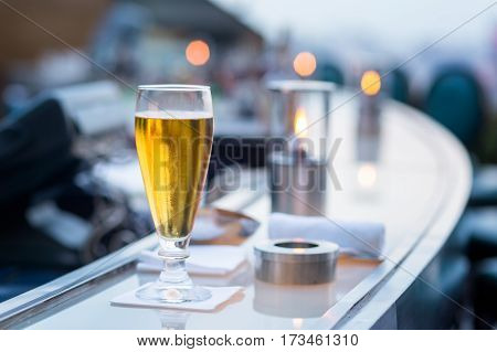 Glass of beer in Bangkok city view point from rooftop of building blue sky and city light Bangkok is the most populated city in Southeast Asia. Bangkok Thailand