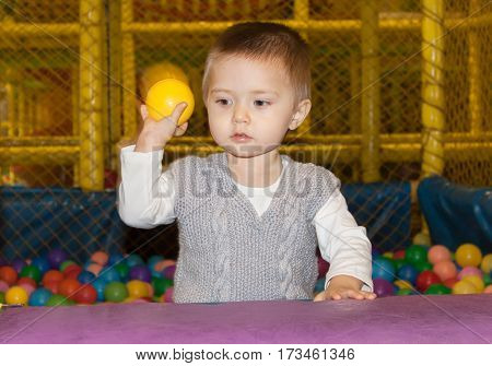 A little boy plays on the Playground with the ball in the first emotions