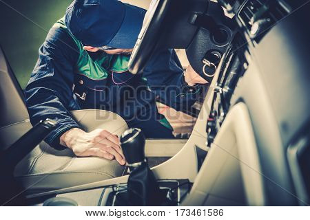 Used Car Maintenance. Auto Service Technician Checking Vehicle Interior Looking For Issues.