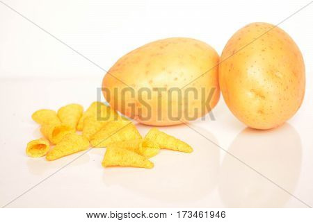 Fresh potatoes and chips on white background, nature, food