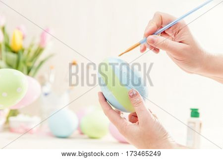 Pastel Easter egg handmade decoration. Brush painting.