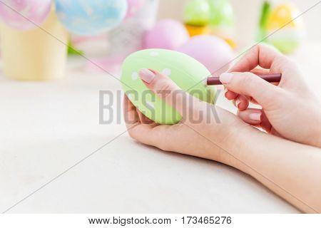 Pastel Easter egg artistic painting. Handmade decoration.
