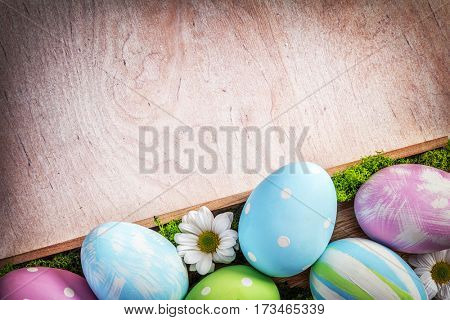 Easter decoration - eggs and flowers on a wood. Holiday time