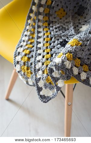 Close Up Of Crocheted Mat On A Chair Still Life