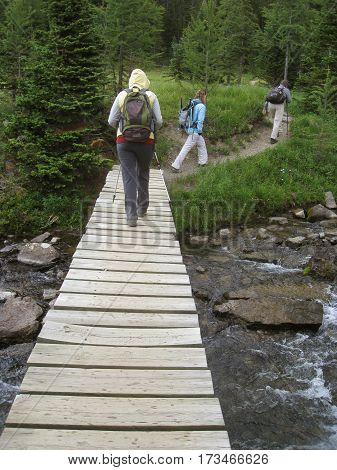 Hikers crossing a ravine in the Rocky Mountains