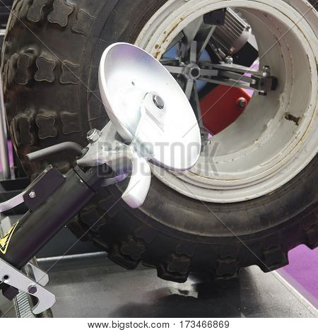The image of a truck wheel on a tire machine