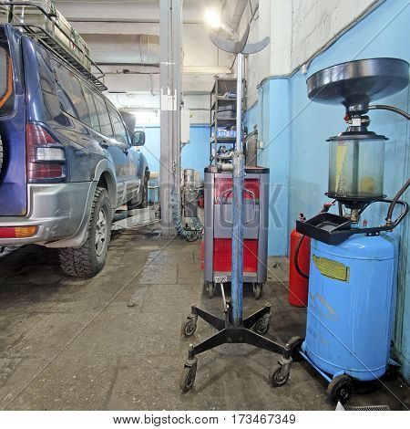 Moscow, Russia - August, 26, 2016: Car on a lift in a car repair station in Moscow, Russia