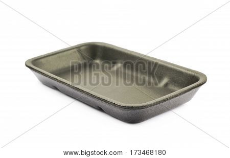 Black plastic foam food packing tray plate isolated over the white background