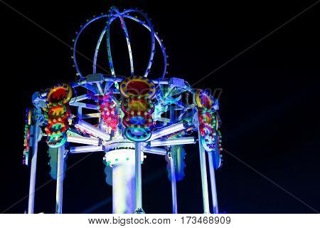 Thrill ride at an amusement park at night.