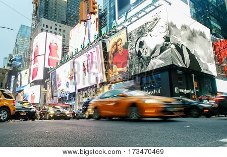New York February 21 2017: Cars are moving along Broadway at Times Square.