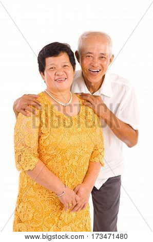 Happy senior aged Asian couple in love. Asian senior couple smiling isolated on white background.