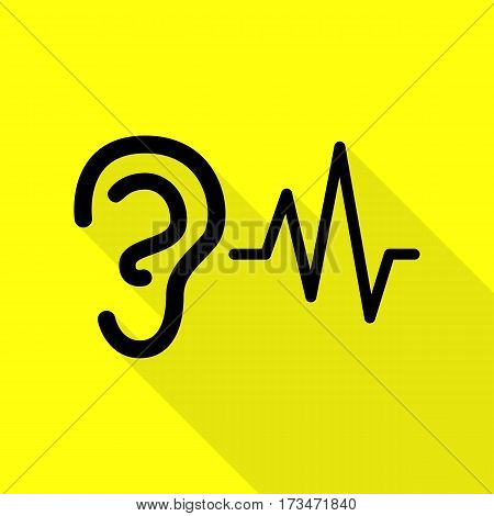 Ear hearing sound sign. Black icon with flat style shadow path on yellow background.
