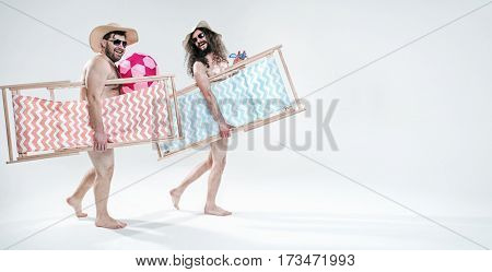 Two funny guys on vacation day, isolated on white background