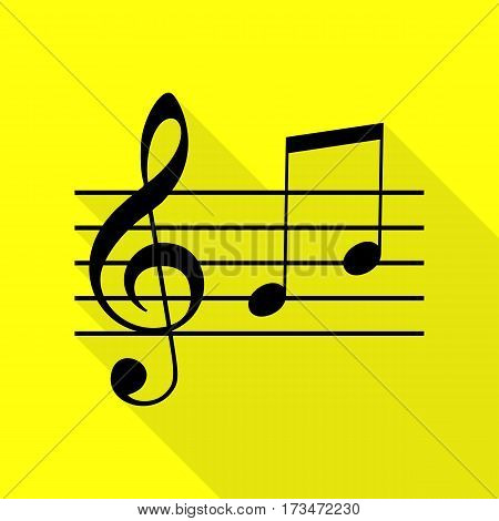 Music violin clef sign. G-clef and notes G, H. Black icon with flat style shadow path on yellow background.