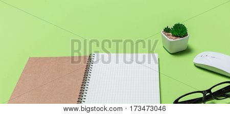 Top View Office Desk Paper Book With Grid And Business Object, Shot From Above.