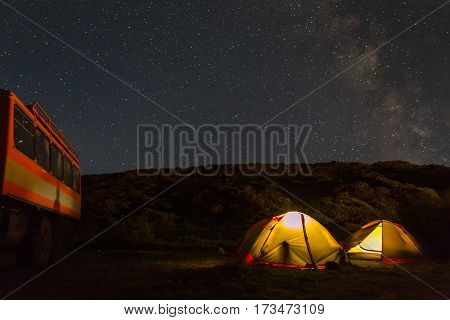 Milky Way in the night sky above the tourist campground. Brookvalley Spokoyny at the foot of outer north-eastern slope of caldera volcano Gorely.