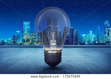 Light Bulb On Building Balcony On City