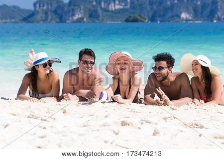 Young People Group On Beach Summer Vacation, Happy Smiling Friends Lying Sand Seaside Sea Ocean Holiday Travel