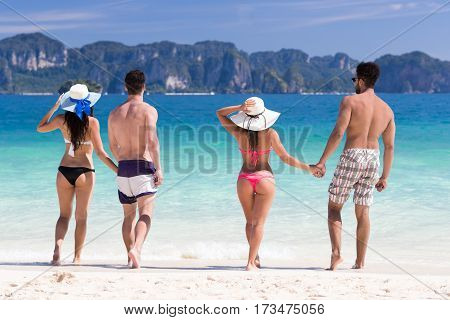 Young People Group On Beach Summer Vacation, Two Couple Holding Hands Friends Walking Seaside Sea Ocean Holiday Travel