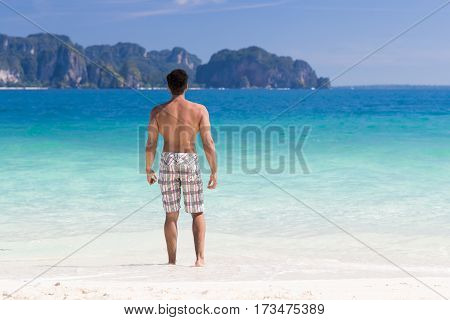 Young Man On Beach Summer Vacation, Guy Standing Back Seaside Blue Water Sea Ocean Holiday Travel