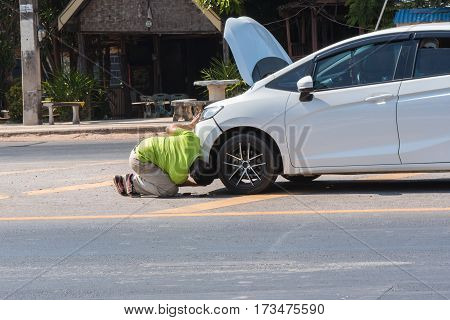 Car Crash Accident On Road,front Of White Car Get Damaged By Accident On The Road