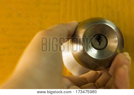 Hands twisting doorknobs or concept and idea image.Close up.