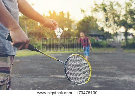 Father and son playing badminton.Family with activity.Zoom in