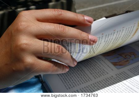 Hand Flipping A Page