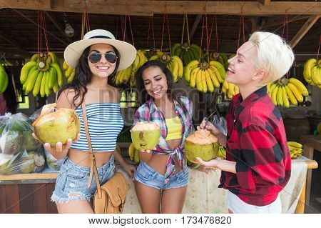 Girld Group Drick Coconut Cocktail Asian Fruits Street Market Buying Fresh Food, Young Friends Tourists Exotic Vacation Tropical Holiday