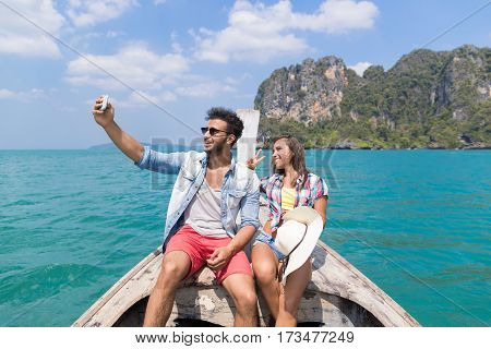 Young Couple Tourist Sail Long Tail Thailand Boat Take Selfie Photo Ocean Sea Vacation Travel Trip Tropical Holiday