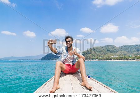 Young Man Tourist Sail Long Tail Thailand Boat Speak Take Selfie Photo On Cell Smart Phone Call Ocean Sea Vacation Travel Trip