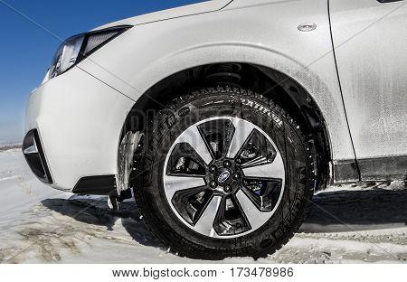 Kazakhstan, Ust-Kamenogorsk, 22 february, 2017: Subaru Forester car fragment, side view, white car