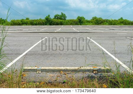 Empty parking lot on blue sky background