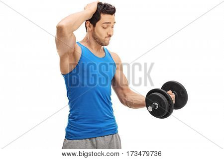 Exhausted man lifting a dumbbell isolated on white background
