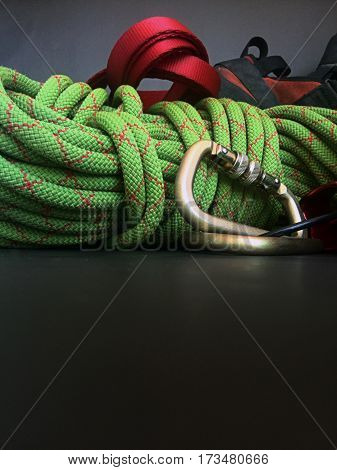 close up of rock climbing rope shoes sling and caribiner