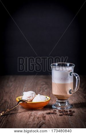 Latte or Capuccino coffe glass with beans and meringue