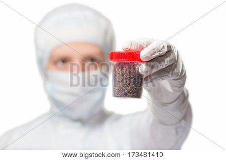 Biologist Shows A Sample Of The Soil In A Test Tube On A White Background