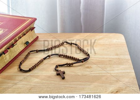 Close up of catholic rosary beads and bible