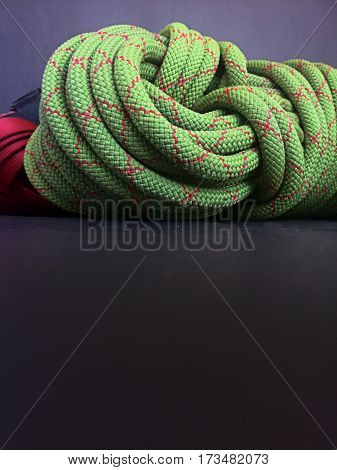 close up of climbing rope coil on blake background