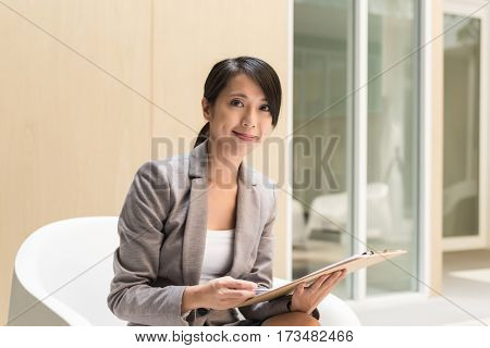 young Asian business executive read the report outside of office