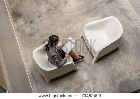 top view of young Asian business executive read the report outside of office