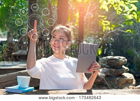 Women using laptop payments online shopping and icon customer network connection on screen in the nature park