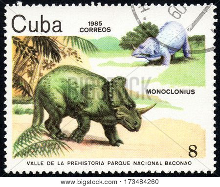UKRAINE - CIRCA 2017: A stamp printed in Cuba shows a extinct animals Monoclonius from the park of dinosaurs in the reserve Baconao the series Valle de la prehistoria parque nac. Baconao circa 1987
