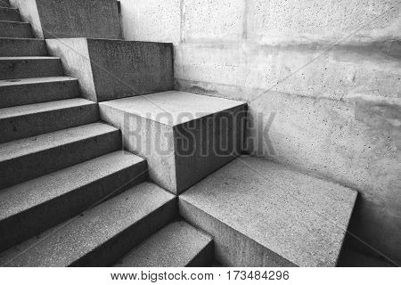 Concrete staircase as abstract architectural background monochromatic image