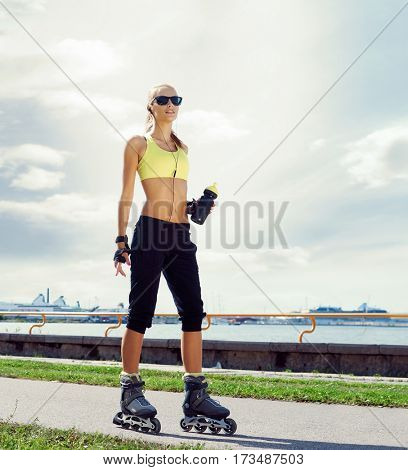 Young, beautiful and fit girl over sky background. Sporty woman rollerblading on skates.