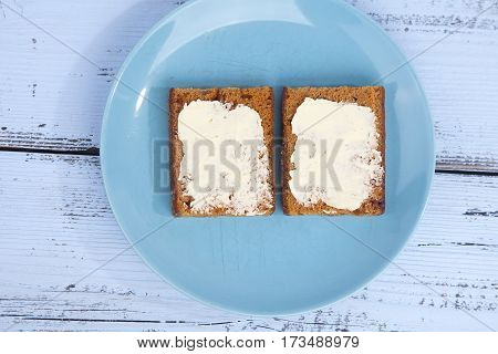 Traditional Dutch cake Ontbijtkoek with traditional butter on wooden background
