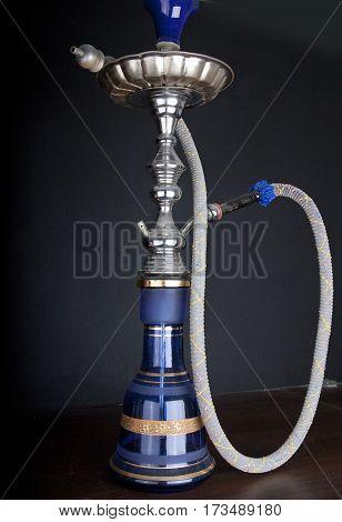 Oriental water pipe on dark black background