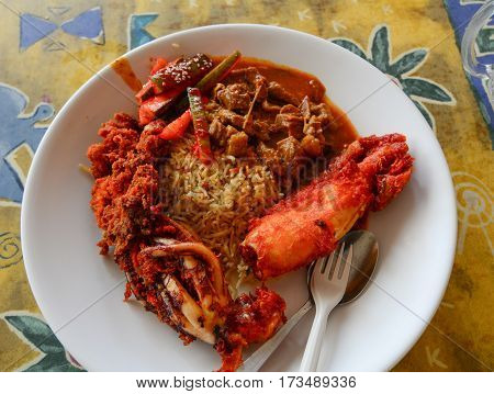Fried rice with seafood - Malaysia cuisine. Close up.